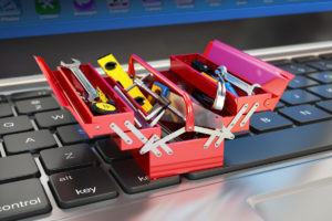 tools_tiny_toolbox_toolkit_on_laptop_keyboard